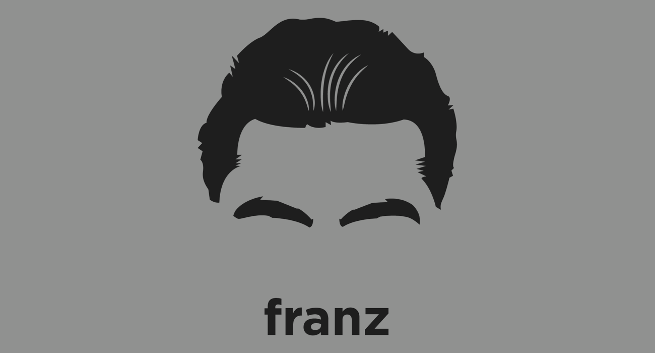 A t-shirt with a minimalist hair based illustration of Franz Kafka: influential author whose work fuses elements of realism and the fantastic, exploring themes of alienation, existential anxiety, guilt, and absurdity