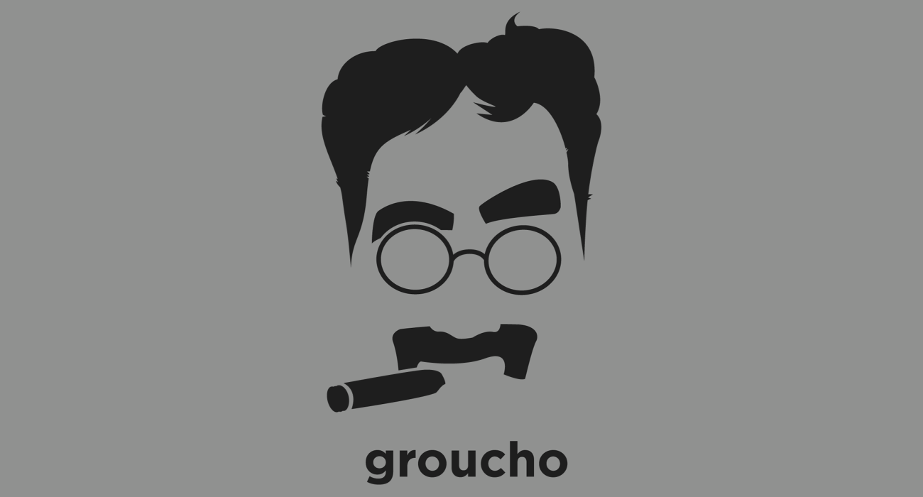 A t-shirt with a minimalist hair based illustration of  Groucho Marx: American comedian and film and television star. He is known as a master of quick wit and widely considered one of the best comedians of the modern era
