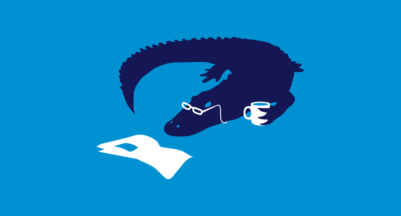 An alligator lounging about reading the morning paper and having a spot of coffee. This doesn't make sense to me either