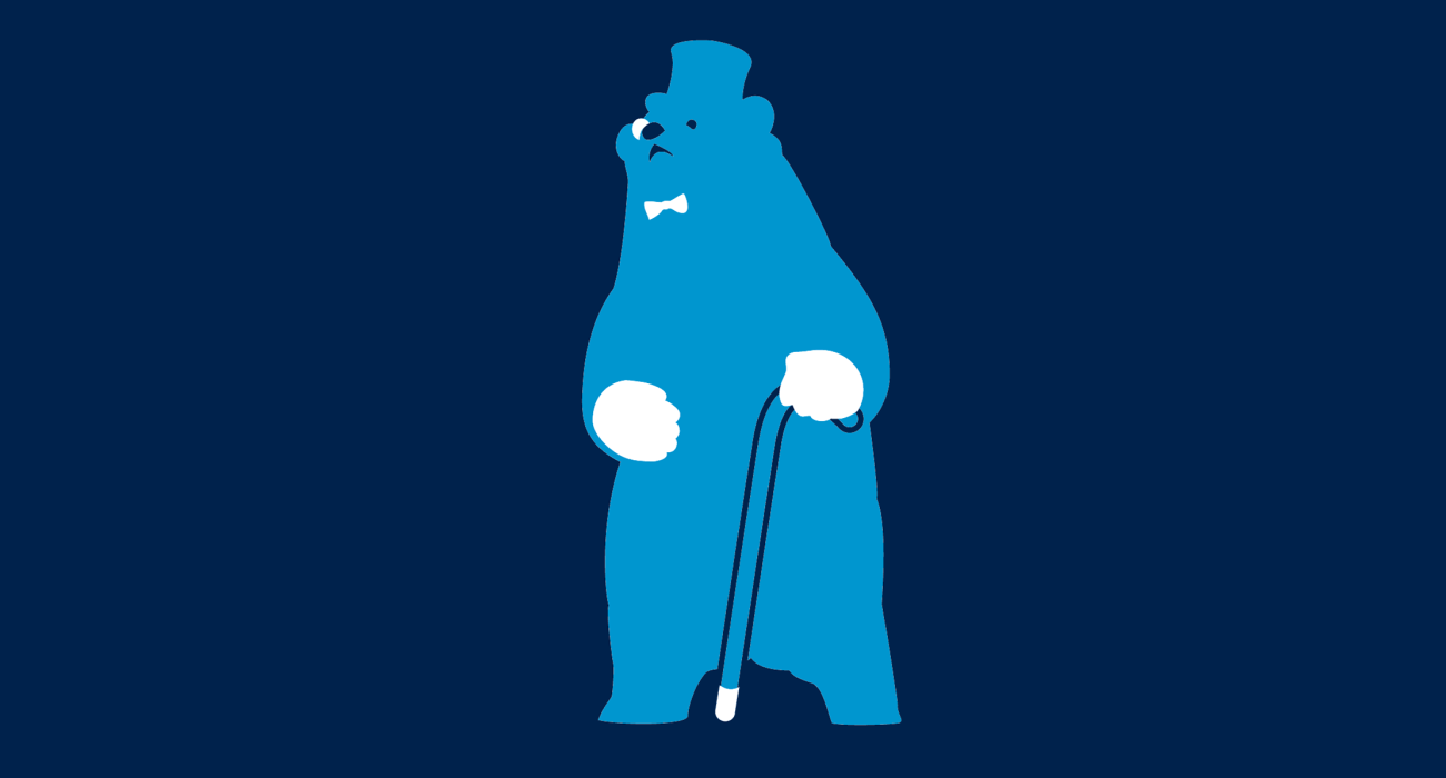 A handsome bear looking regal in his top hat, monocle, bow tie and white gloves