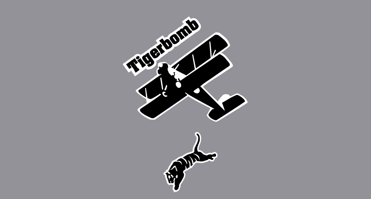 A WWI style biplane delivery it's most deadly of payloads: an angry tiger! Sure to sweep the trenches clean. Oh it's also the name of a great Guided by Voices EP